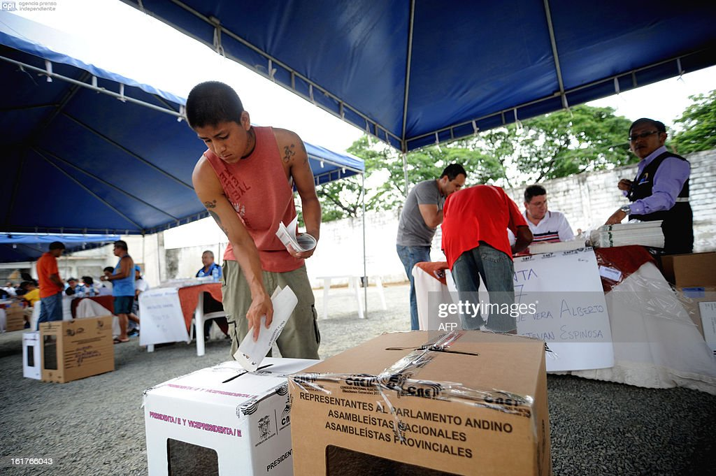 An inmate without a sentence casts his vote at the Social Rehabilitation Centre in Guayaquil, Ecuador, on February 15, 2013. There are over 8000 inmates without sentence in Ecuador who can vote in advance for Sunday's national election. Ecuadoran President Rafael Correa is favored to cruise to a new term Sunday to cement a 'socialist revolution' that has brought stability to a nation where several leaders were forced out before him. An outspoken voice of the Latin American left and friend of ailing Venezuelan President Hugo Chavez, the charismatic, US-educated economist is far ahead of his seven rivals in all opinion polls after six years in office. AFP PHOTO / CESAR PASACA