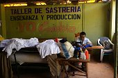An inmate works at the tailoring workshop of the Apanteos prison in Santa Ana 66 km west of San Salvador on July 15 2016 Apanteos is a model prison...