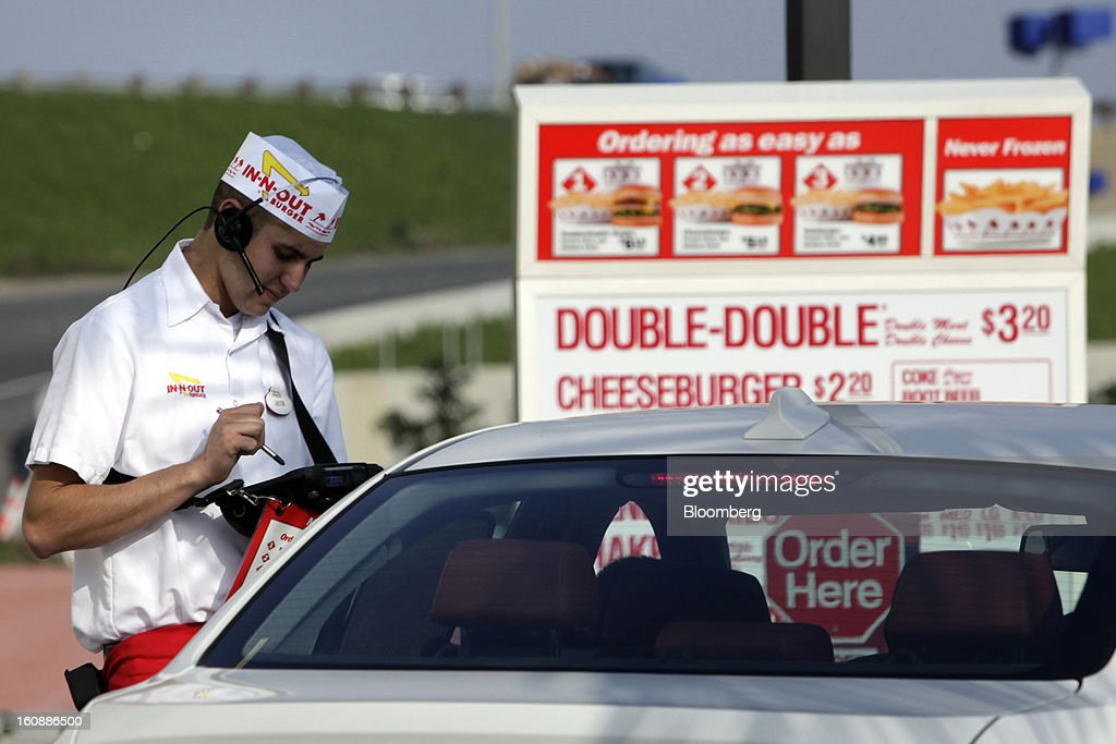 An In-N-Out Burger employee takes a drive-thru order on a wireless tablet at a restaurant in Costa Mesa, California, U.S., on Wednesday, Feb. 6, 2013. In-N-Out, with almost 280 units in five states, is valued at about $1.1 billion based on the average price-to-earnings, according to the Bloomberg Billionaires Index. Photographer: Patrick T. Fallon/Bloomberg via Getty Images