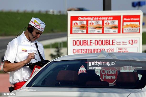 An InNOut Burger employee takes a drivethru order on a wireless tablet at a restaurant in Costa Mesa California US on Wednesday Feb 6 2013 InNOut...