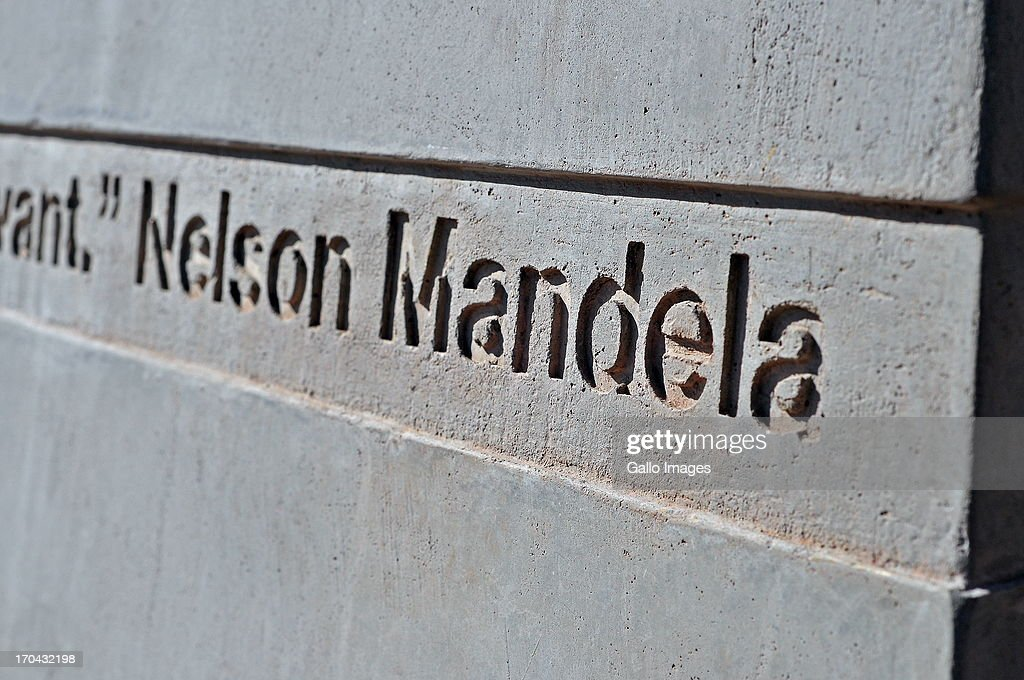 An inscription from the 'Shadow Boxing' monument outside Chancellor House, historically the law firm of Nelson Mandela and Oliver Tambo on June 10, 2013 in Johannesburg, South Africa. Nelson Mandela has been admitted to hospital and it is reported he is in a serious but stable condition.