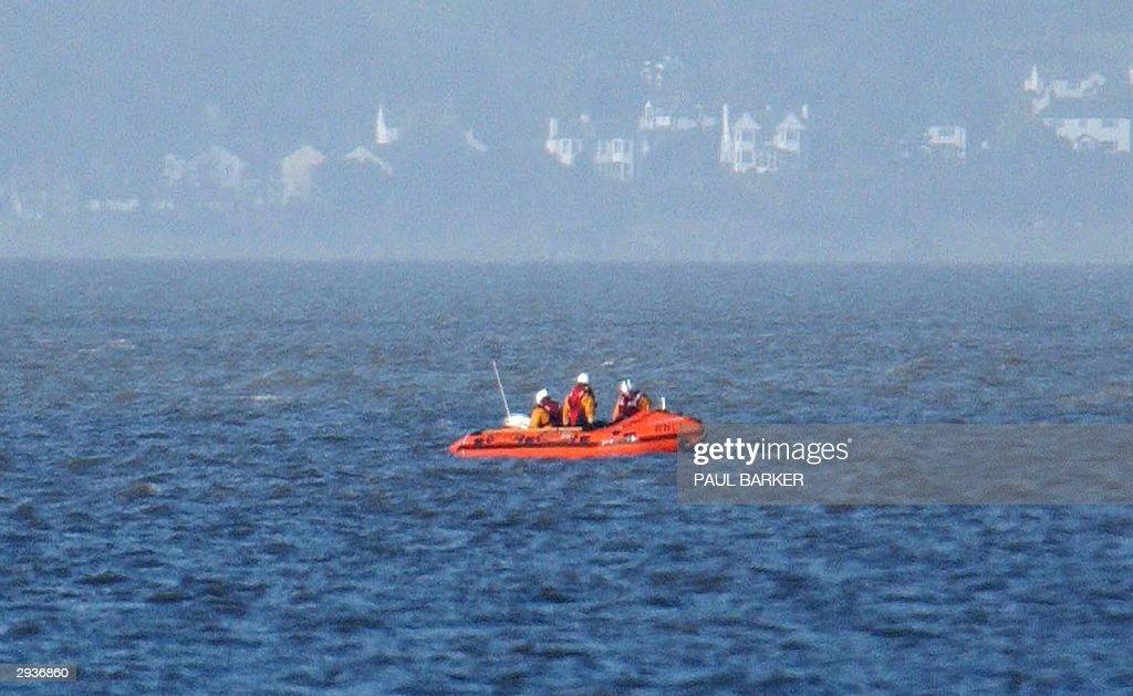 An inshore lifeboat continues to search 06 February 2004 Morecambe Bay where eighteen people thought to be Chinese workers digging for shellfish on...