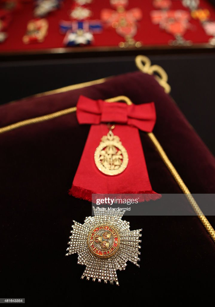 An insignia for a Dame Commander of the Order of the Bath is displayed at The Royal Welcome exhibition Summer opening at Buckingham Palace on July 23, 2015 in London, England. Last year the Royal Family welcomed around 62,000 guests to Buckingham Palace, at State Visits, receptions, Garden Parties, Investitures and private audiences. At the Summer Opening of the Palace, displays throughout the State Rooms have recreated the settings for some of these royal occasions, and give an insight into what goes into creating a royal welcome, from the laying of a table at a State Banquet, to the creation of an outfit worn by Her MajestyThe Queen to receive visitors.