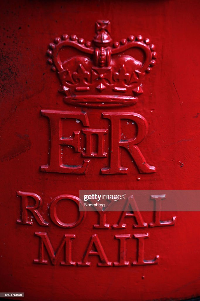 An insignia sits on display on a Royal Mail Group Ltd. pillar box in London, U.K., on Thursday, Sept. 12, 2013. Royal Mail Group Ltd., the U.K.'s 360-year-old postal service, intends to hold an initial public offering of a majority stake 'in the coming weeks' to help the company gain a competitive edge against European rivals. Photographer: Matthew Lloyd/Bloomberg via Getty Images