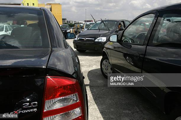An inspector maneuvers new flex combustible vehicles made in Brazil by US carmaker General Motors at the parking lot of an authorized dealer in Sao...