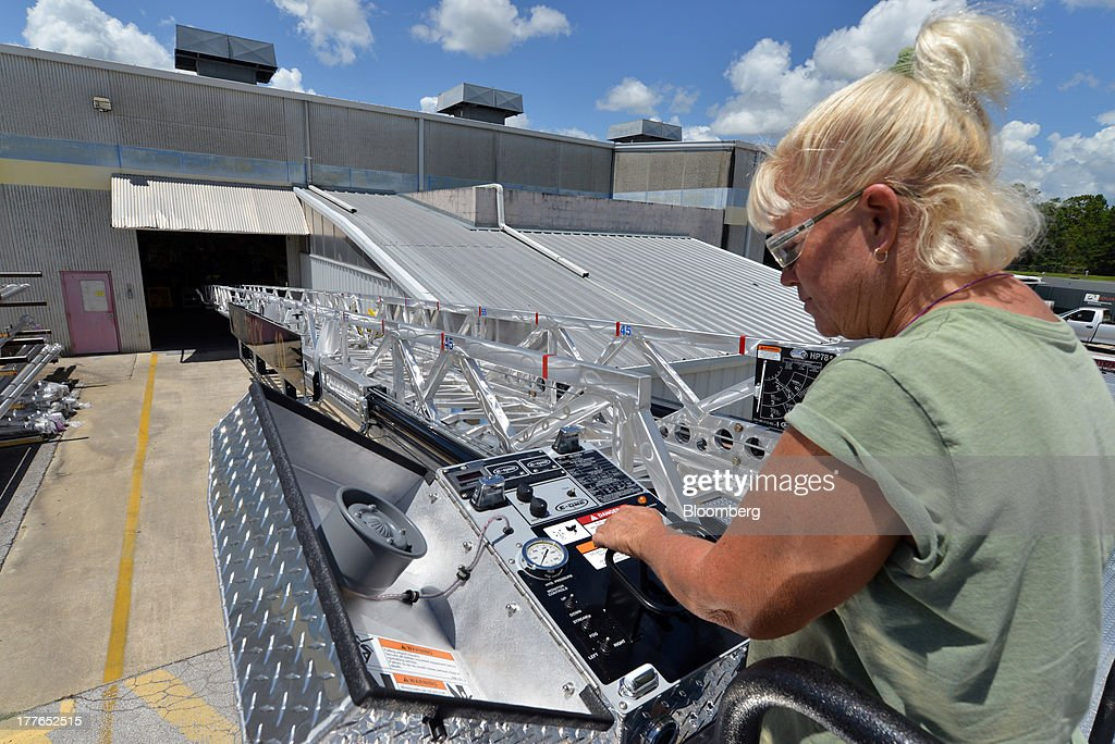 An inspector with E-ONE Inc. checks out the controls on an aerial truck at the E-ONE factory, on Tuesday, Aug. 20, 2013, in Ocala, Florida, U.S. The U.S. Census Bureau is scheduled to release durable goods figures on Aug. 26. Photographer: Mark Elias/Bloomberg via Getty Images