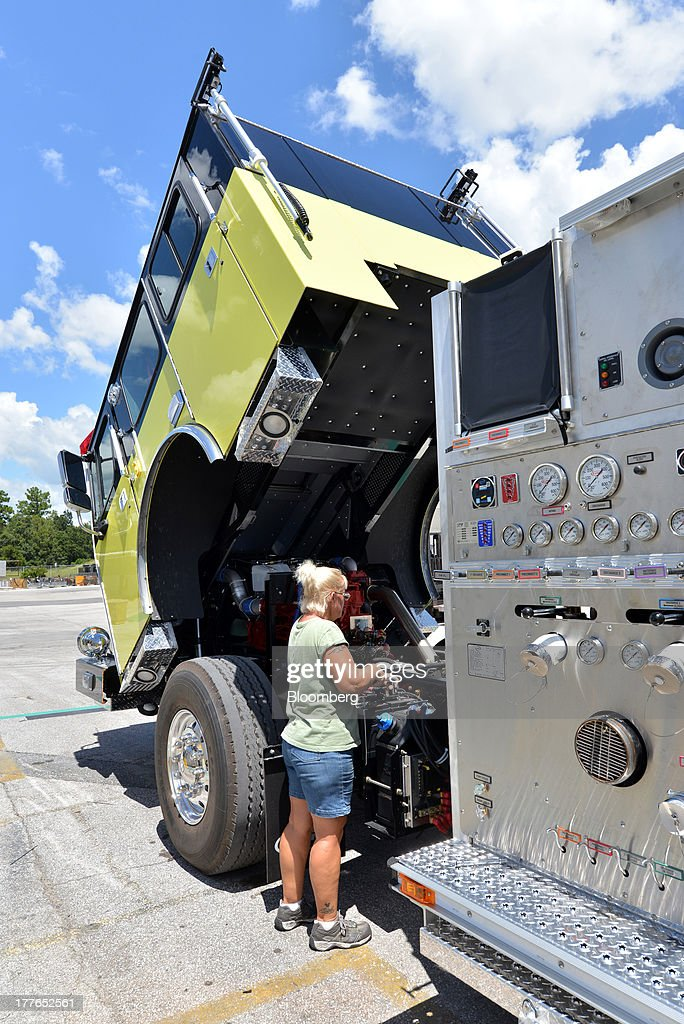 An inspector with E-ONE Inc., checks the batteries on an aerial truck at the E-ONE factory, on Tuesday, Aug. 20, 2013, in Ocala, Florida, U.S. The U.S. Census Bureau is scheduled to release durable goods figures on Aug. 26. Photographer: Mark Elias/Bloomberg via Getty Images