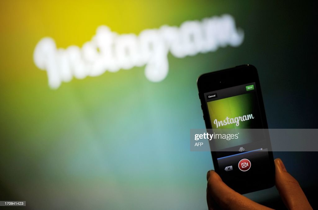 An Instagram employee displays Instagram's new video function at Facebook's corporate headquarters during a media event in Menlo Park California on...