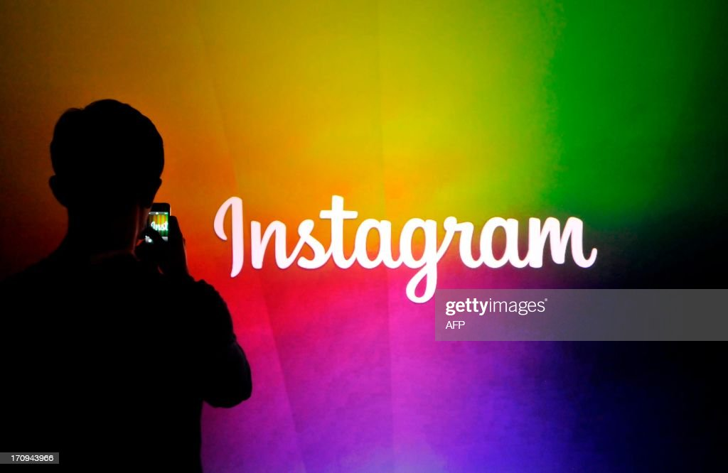 An Instagram employee takes a video using Instagram's new video function at Facebook's corporate headquarters during a media event in Menlo Park, California on June 20, 2013. AFP Photo /Josh EDELSON