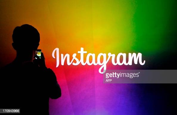 An Instagram employee takes a video using Instagram's new video function at Facebook's corporate headquarters during a media event in Menlo Park...