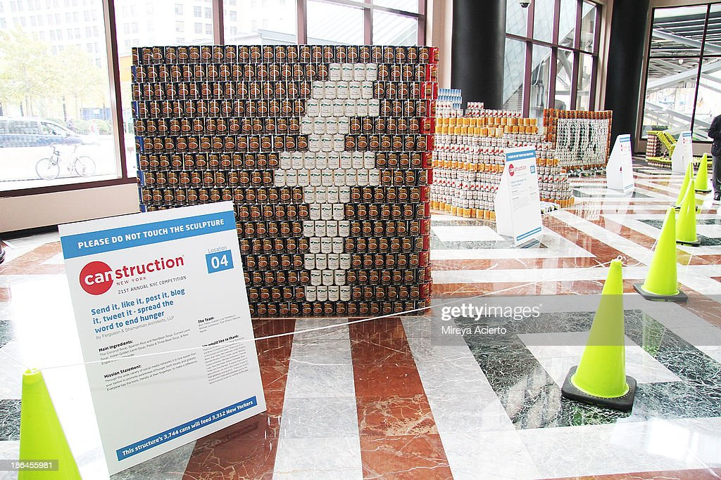 An installation art piece 'Send it, like it, post it, blog it, tweet it- spread the word to end hunger' by Ferguson & Shamamian Architects, LLP is seen at Canstruction: 21st Annual NYC Competition - Media Preview Event at Brookfield Place Waterfront Plaza on October 31, 2013 in New York City.