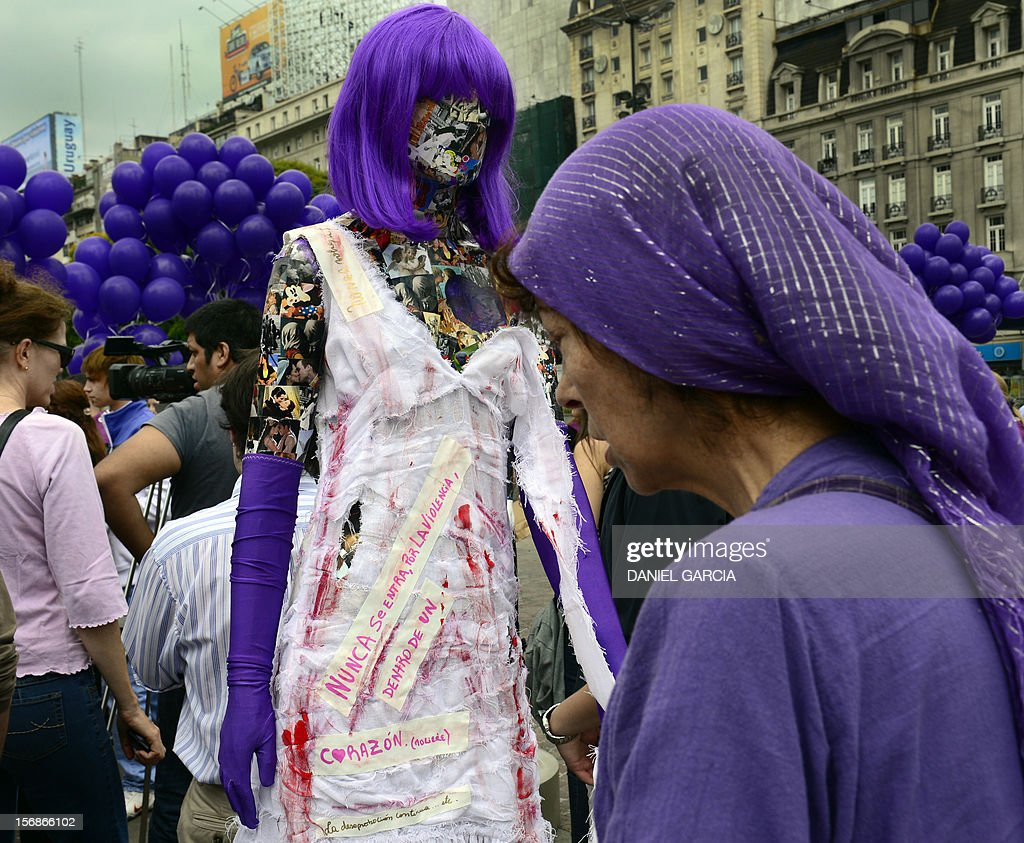 An installation consisting in a series of dummies intervened to raise awareness about gender violence, on November 23, 2012 are set up around the obelisk in Buenos Aires, ahead of the International Day for the Elimination of Violence against Women to be held on November 25. AFP PHOTO/DANIEL GARCIA