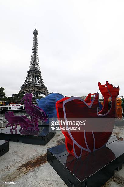 An installation of 140 animal shape sculptures is set on the deck of a barge in front of the Eiffel Tower in Paris as part of Gad Weil's artistic...