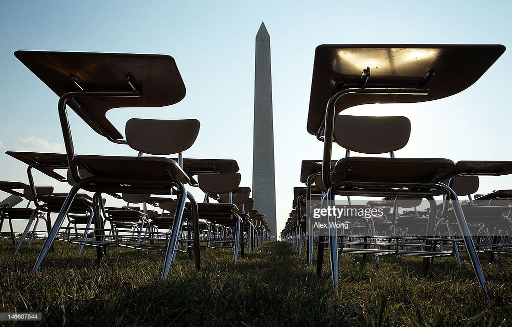 An installation of 857 empty school desks, representing the number of students nationwide who are dropping out every hour of every school day, is on display at the National Mall June 20, 2012 in Washington, DC. The installation was presented by not-for-profit organization College Board to call upon presidential candidates who are running for the White House to make education a more prominent issue in the 2012 campaigns and put the nation's schools back on track.