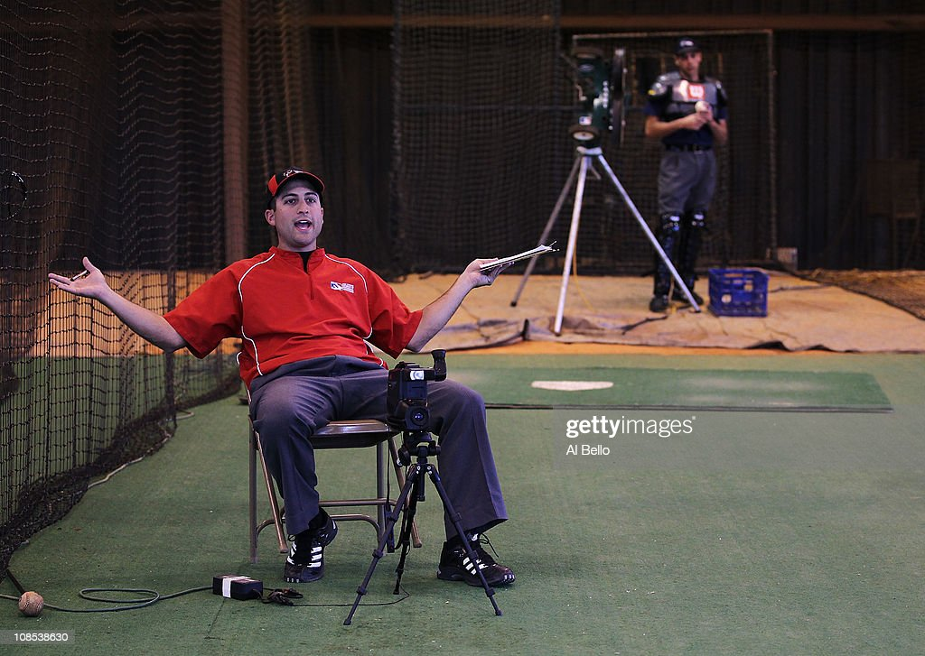 An instructor who is playing the role of a team manager from a simulated baseball game of balls and strikes in the indoor batting cages yells at a student umpire during the Jim Evans Academy of Professional Umpiring on January 28, 2011 at the Houston Astros Spring Training Complex in Kissimmee, Florida. Jim Evans was a Major League Umpire for 28 years that included umpiring four World Series. Many of his students have gone on to work on all levels of baseball including the Major Leagues.