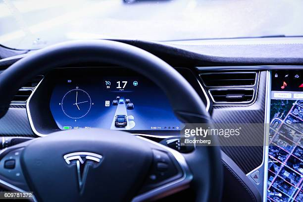 An instrument panel illustrates the road ahead using Autopilot technology just prior to the Tesla Motors Inc 80 software update inside a Model S P90D...