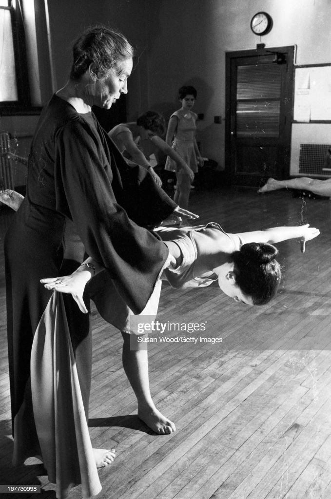 An instrutor helps a female students at Barnard College in a posture contest New York New York January 1955