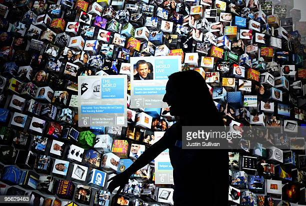 An Intel employee demonstrates the Intel Infoscape interactive touchscreen display at the 2010 International Consumer Electronics Show at the Las...