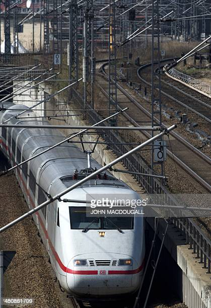 An Inter City Express train of the Deutsche Bahn leaves the Ostbahnhof railway station in Berlin on March 27 2014 AFP PHOTO / JOHN MACDOUGALL