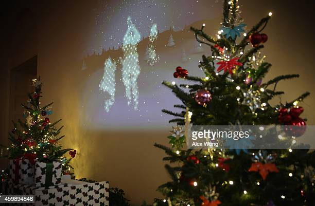 An interactive installation which visualizes visitors in a snowscape projected on the wall with live movement is seen at the East Garden Room of the...