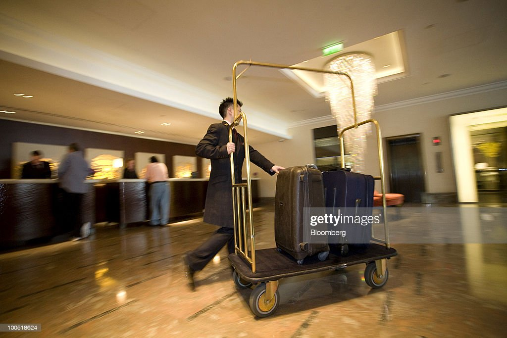 An Intercontinental Hotels Group Plc Employee Carries Luggage In London U K On Tuesday