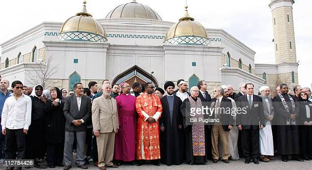 An interfaith group rallies at the Islamic Center of America to show unity and condemn the planned Good Friday protest by Pastor Terry Jones at the...