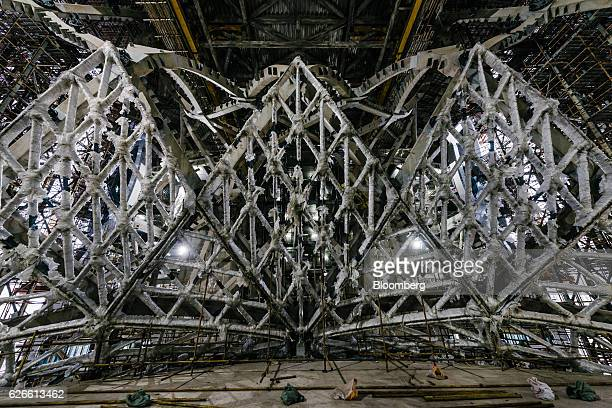 An interior structure stands wrapped under plastic covering at Morpheus Melco Crown Entertainment Ltd's new hotel tower under construction at the...