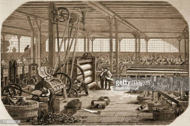 An interior view of a rubber processing factory shows workers and machinery circa 1858