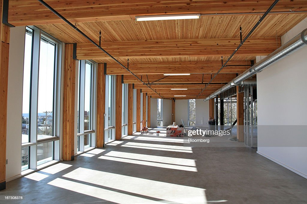 An interior view of the Bullitt Foundation headquarters is seen in Seattle, Washington, U.S., in this undated photograph. The building confers environmental benefits with heavy timber framing that sequesters carbon, triple-glazed energy-saving windows, and high ceilings that allow daylight to replace electric lights on most days. Photographer: James S. Russell/Bloomberg via Getty Images