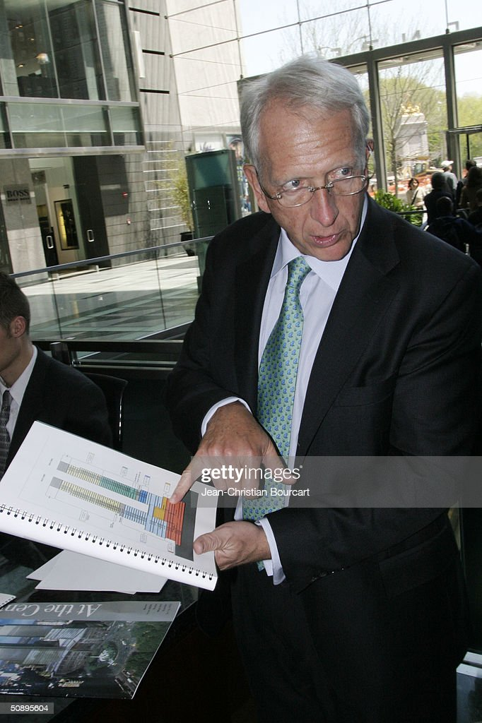 An interior view of the new Time Warner Building is seen in Columbus Circle behind architect Howard Elkus (R) April 29, 2004 in the Manhattan borough of New York City. The building houses many businesses including the Time Warner World Headquarters, CNN offices, Five Star Mandarin Oriental Hotel, One Central Park Luxury Residences, restaurants and mall type shopping stores.