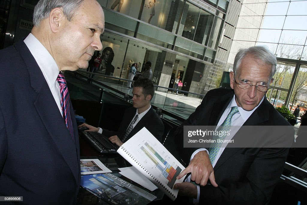 An interior view of the new Time Warner Building is seen in Columbus Circle behind architect Howard Elkus (R) and developer Ken Himmel (L) April 29, 2004 in the Manhattan borough of New York City. The building houses many businesses including the Time Warner World Headquarters, CNN offices, Five Star Mandarin Oriental Hotel, One Central Park Luxury Residences, restaurants and mall type shopping stores.