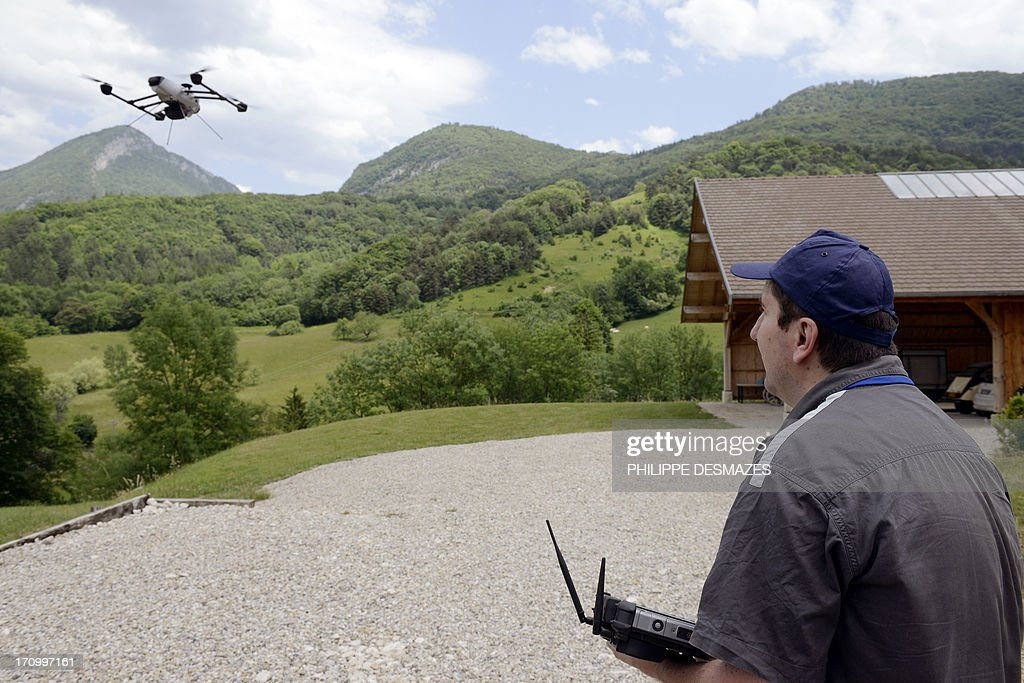 An intern at the Delta drone company pilots a drone during a training session on June 20, 2013 in Quaix-en-Chartreuse near Grenoble, eastern France. Delta drone is one of France's leaders in the drone sector for civil purpose.