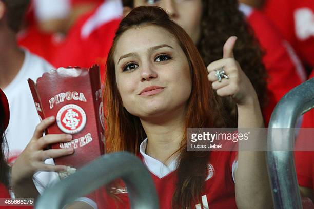 An Internacional fan cheers before a match between Internacional and Vitoria as part of Brasileirao Series A 2014 at Beira Rio Stadium on April 19...