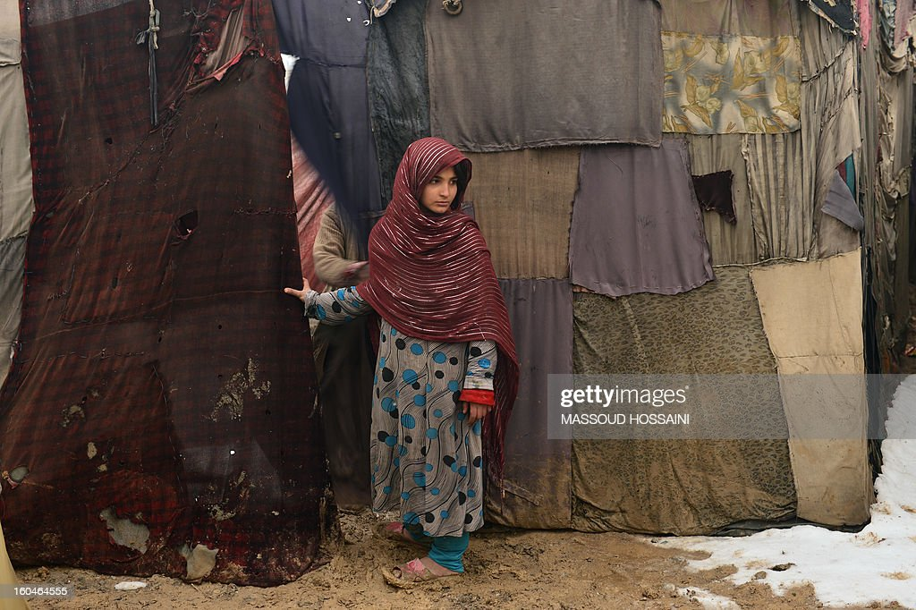 An internally displaced Afghan child waits to receive donations at Nassaji Camp, east of Kabul, on February 1, 2013. With an ongoing Taliban-led insurgency plaguing the poverty-stricken country, Afghanistan's internally displaced population has reached half a million according to the UN refugee agency, though the actual number is likely to be much higher. AFP PHOTO/Massoud HOSSAINI