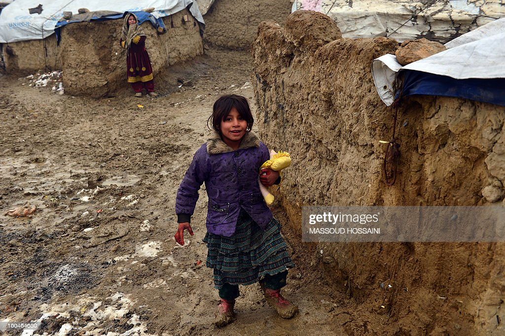 An internally displaced Afghan child walks at Nassaji Camp, east of Kabul, on February 1, 2013. With an ongoing Taliban-led insurgency plaguing the poverty-stricken country, Afghanistan's internally displaced population has reached half a million according to the UN refugee agency, though the actual number is likely to be much higher. AFP PHOTO/Massoud HOSSAINI