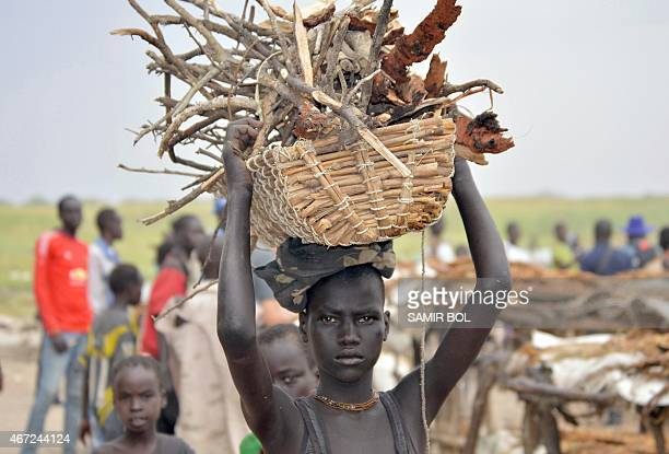 An internally displaced girl carries firewood in Ganyiel village of Panyijar County of Unity State on March 21 2015 WFP Executive Director Ertharin...