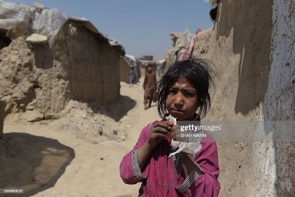An internally-displaced Afghan girl looks on at refugee camp in Kabul on May 31, 2016. The number of people internally displaced by war in Afghanistan has doubled since 2012 to 1.2 million, Amnesty International said on May 31, citing government neglect and a lack of international attention. In its report entitled 'My children will die this winter: Afghanistan's broken promise to the displaced', the rights group warned that a lack of basic services had pushed many of those uprooted from their homes to the brink of survival. / AFP / SHAH