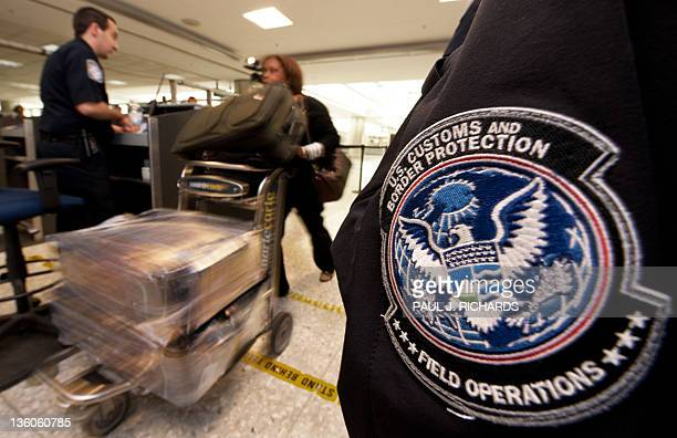 An international air traveler is cleared by a US Customs and Border Protection Officer and is approved to enter the United States inside the US...