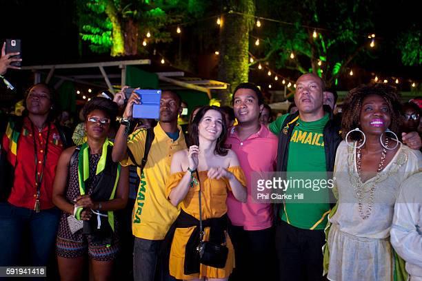 An International Brazilian and Jamaican crowd in Jamaica House celebrate Usain's Bolt's 200m Olympic victory Rio 2016 Gavea Jockey Club Rio de Janeiro