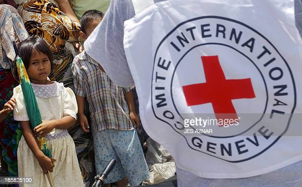 An International Committee of the Red Cross personnel attends to displaced Muslim residents in Datu Saudi Ampatuan in southern Philippine island of...