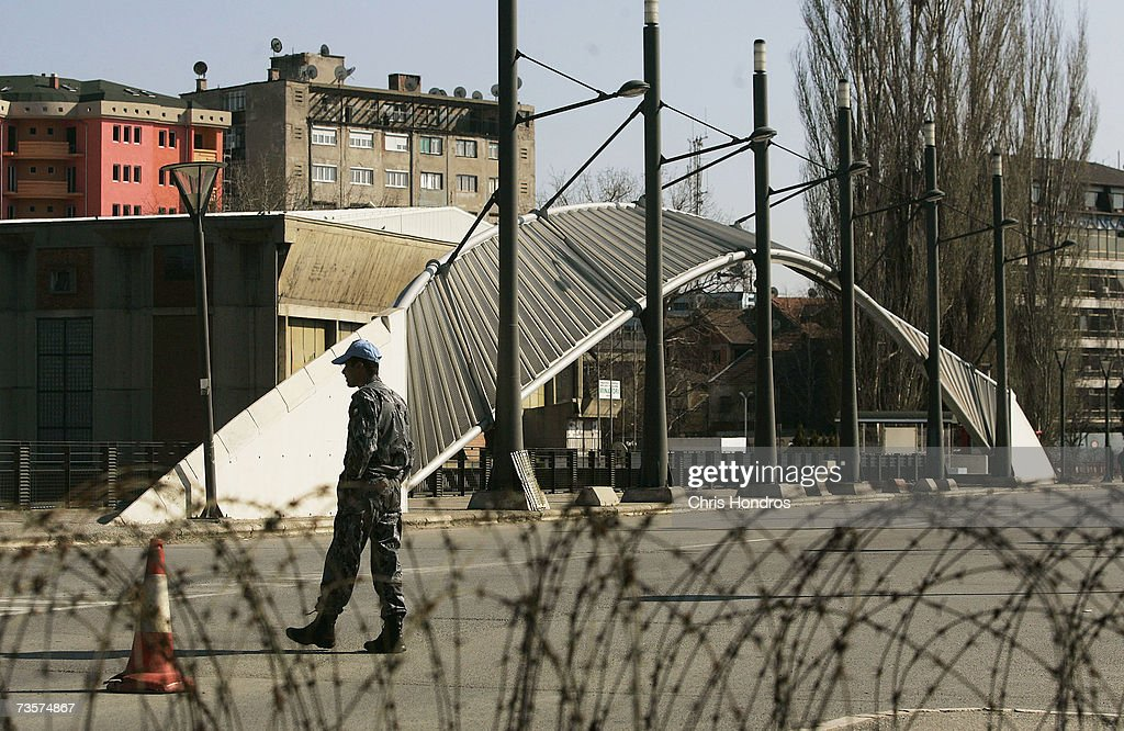 An international peacekeeper from Jordan keeps watch on the bridge that separates the Serbs from the Albanians March 14, 2007 in Mitrovica, Kosovo. Before 1999 Mitrovica was a town where Serbs and ethnic Albanians lived side-by-side. It is now is Kosovo's most glaring symbol of separation, as the two populations quickly separated themselves after the fall of the Serbian government in Kosovo and occupied opposite banks of the Ibar river.