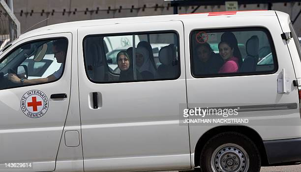 An International Red Cross van transports Palestinian women prisoners who were freed from jail in return for a video of Israeli soldier Gilad Shalit...
