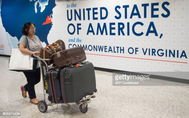 An international traveler leaves the Customs and Immigration area of Dulles International Airport June 29 outside Washington DC in Dulles Virginia...