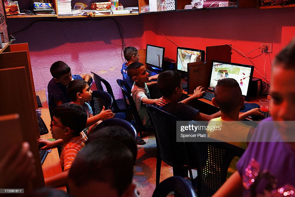 An internet cafe is utilized by young Lebanese and Syrian children in a poor neighborhood with a high concentration of Syrian refugees on July 01, 2013 in Beirut, Lebanon. Currently the Lebanese government officially hosts 546,000 Syrians with an estimated additional 500,000 who have not registered with the United Nations. Lebanon, a country of only 4 million people, is now home to the largest number of Syrian refugees who have fled the conflict. The situation is beginning to put a huge social and political strains on Lebanon as there is currently no end in sight to the war in Syria.