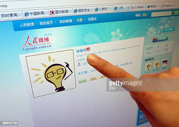 An Internet user points to the account page in Beijing on February 22 2010 of China's President Hu Jintao on a microblogging platform operated by the...