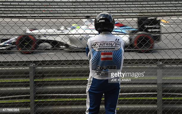 An intervention marshal watches Williams Martini Racing's Brazilian driver Felipe Massa competing at the Red Bull Ring in Spielberg Austria on June...
