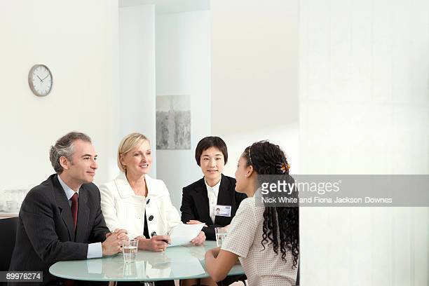 An interview in front of a panel
