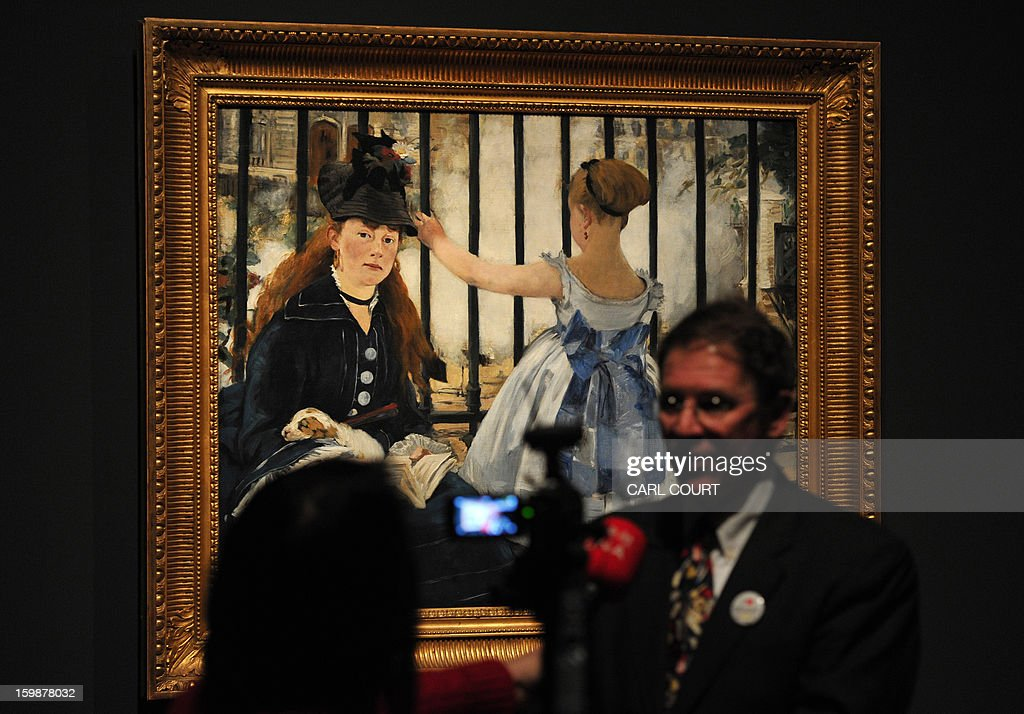 An interview is conducted in front of a painting by French artist Edouard Manet entitled 'The Railway' at the Royal Academy of Arts in central London on January 22, 2013. Forming part of the 'Manet: Portraying Life' exhibition, it is due to be displayed from January 26 to April 14.