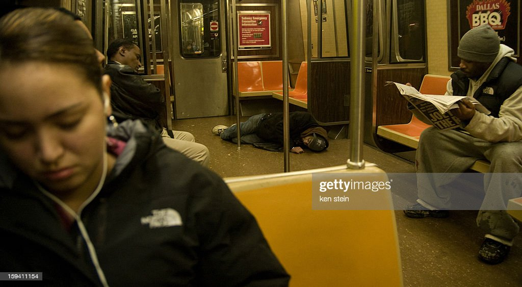 CONTENT] an intoxicated man falls asleep on a brooklyn subway car floor and proceeds to urinate on himself. the passengers don't seem to notice.