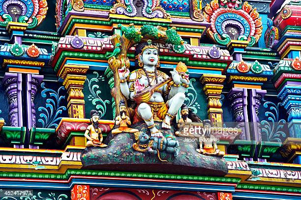 An intricate colorful statue of Shiva at a Hindu temple.